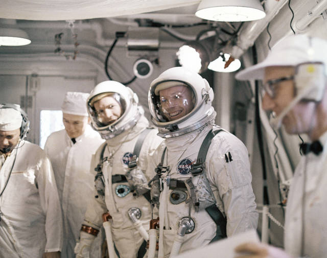 "FILE - In this March 16, 1966 file photo Astronauts Neil A. Armstrong and David R. Scott arrive, March 16, 1966 at Complex 19 for a simulated test in preparation for flight. The family of Neil Armstrong, the first man to walk on the moon, says he has died at age 82. A statement from the family says he died following complications resulting from cardiovascular procedures. It doesn't say where he died. Armstrong commanded the Apollo 11 spacecraft that landed on the moon July 20, 1969. He radioed back to Earth the historic news of ""one giant leap for mankind."" Armstrong and fellow astronaut Edwin ""Buzz"" Aldrin spent nearly three hours walking on the moon, collecting samples, conducting experiments and taking photographs. In all, 12 Americans walked on the moon from 1969 to 1972.  (AP Photo/FILE)  ORG XMIT: NY210"