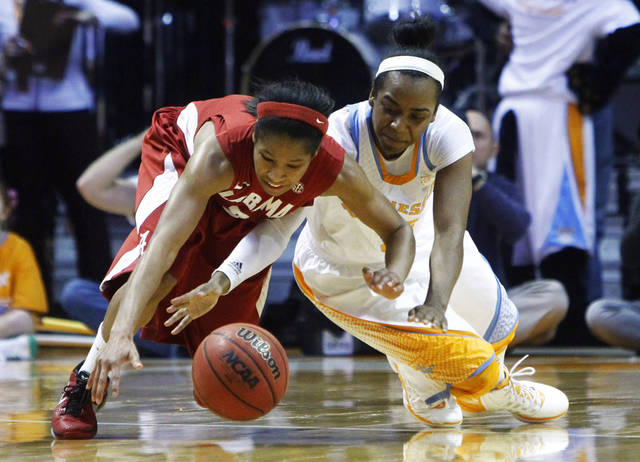 Tennessee Ariel Massengale, right, battles for the ball with Alabama's Jasmine Robinson in the first half of an NCAA college basketball game on Sunday, Jan. 20, 2013, in Knoxville, Tenn. (AP Photo/Wade Payne)