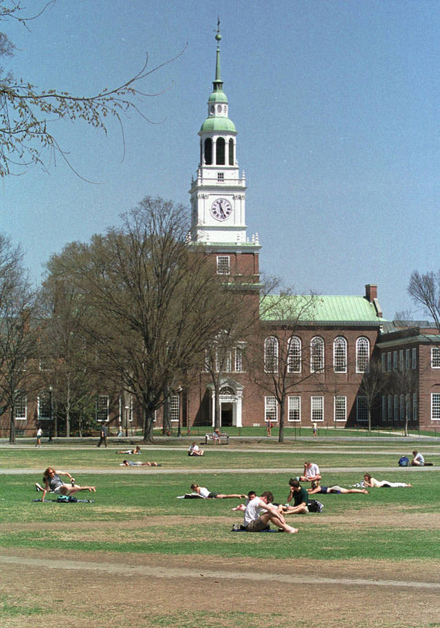 FILE--In this May 1, 2001 photo, Dartmouth College students lounge on a lawn on the campus in Hanover, N.H. High school students hoping to earn college credits through Advanced Placement exams soon will be out of luck at Dartmouth College, which has concluded the tests aren't as rigorous as its own classes. (AP Photo/Lee Marriner, File)