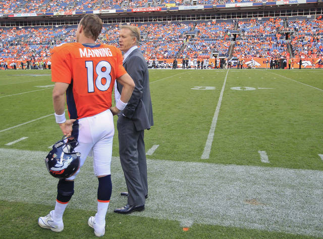 Executive vice president of football operations John Elway, right, talks with Denver Broncos quarterback Peyton Manning (18) during the fourth quarter of an NFL football game against the Oakland Raiders, Sunday, Sept. 30, 2012, in Denver. (AP Photo/David Zalubowski)