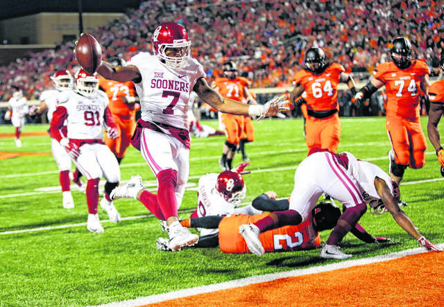 Sooners roll to win over Cowboys