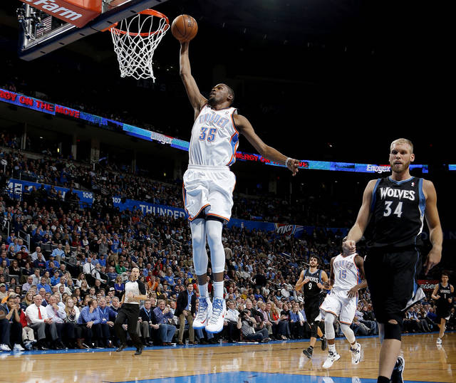 Oklahoma City's Kevin Durant (35) dunks the ball beside Minnesota's Greg Stiemsma (34) during an NBA basketball game between the Oklahoma City Thunder and the Minnesota Timberwolves at Chesapeake Energy Arena in Oklahoma City, Wednesday, Jan. 9, 2013.  Photo by Bryan Terry, The Oklahoman