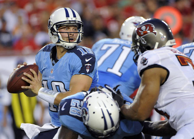 Tennessee Titans quarterback Jake Locker (10) looks for an open receiver against the Tampa Bay Buccaneers during the first half of an NFL preseason football game Friday, Aug. 17, 2012, in Tampa, Fla. (AP Photo/Brian Blanco)