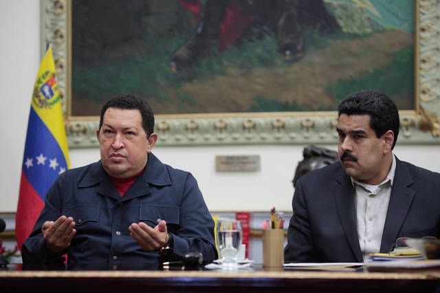 In this photo released by Miraflores Press Office, Venezuela&#039;s President Hugo Chavez , left, speaks beside his Vice-President Nicolas during a televised speech form his office at Miraflores Presidential palace in Caracas, Venezuela, Saturday, Dec. 8, 2012. Chavez announced Saturday night that his cancer has returned and that he will undergo another surgery in Cuba. Chavez, who won re-election on Oct. 7, also said for the first time that if his health were to worsen, his successor would be Vice President Nicolas Maduro.(AP Photo/Miraflores Press Office, Marcelo Garcia)