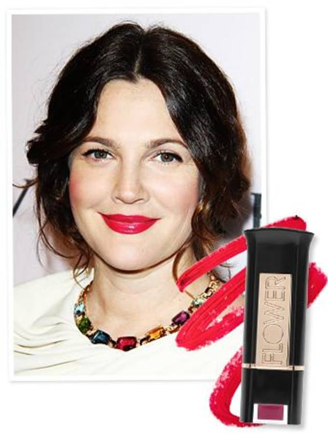 Drew Barrymore's lipstick is Flower Beauty Kiss Stick in Petunia Petals.
