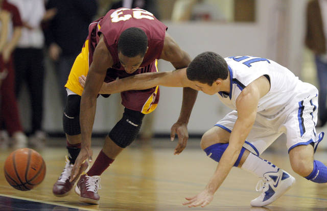 Deer Creek's Joel Blumenthal and Putnam City North's  Tajon Jones (23)fight for a loose during a game at the Bruce Gray Invitational at Deer Creek high school, Friday, Jan. 20, 2012, in Oklahoma City, Okla. Photo by Sarah Phipps, The Oklahoman