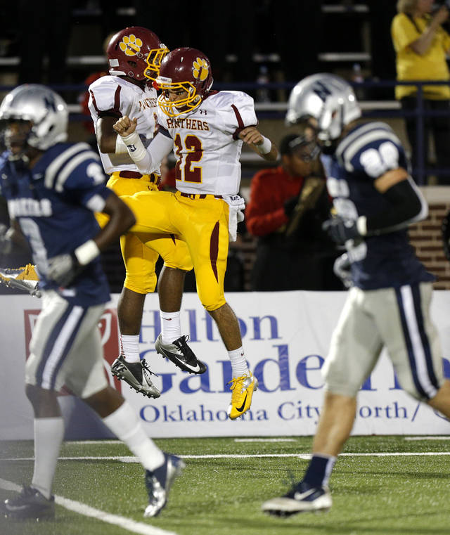 Putnam City North&#039;s Kaedyn Fuller, left, and John Simon celebrate after a touchdown against Edmond North during a high school football game at Wantland Stadium in Edmond, Okla., Friday, September 21, 2012. Photo by Bryan Terry, The Oklahoman