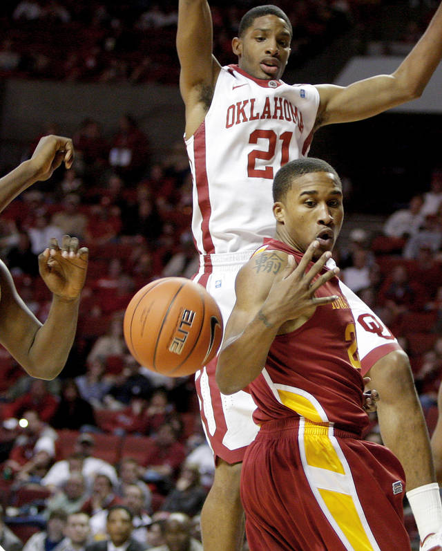 Iowa State's Tyrus McGee (25) and Oklahoma's Cameron Clark (21) go for the ball during an NCAA basketball game between the University of Oklahoma Sooners (OU) and the Iowa State Cyclones (ISU) at the Lloyd Noble Center in Norman, Saturday, Feb. 4, 2012. Photo by Bryan Terry, The Oklahoman