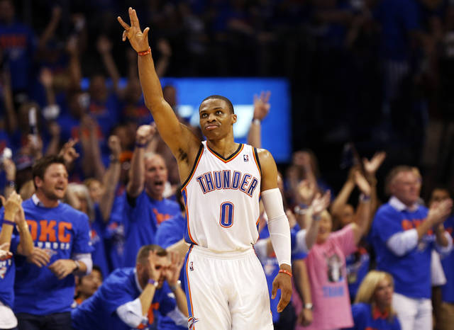 Oklahoma City's Russell Westbrook (0) reacts after hitting a 3-point shot in the fourth quarter during Game 7 in the first round of the NBA playoffs between the Oklahoma City Thunder and the Memphis Grizzlies at Chesapeake Energy Arena in Oklahoma City, Saturday, May 3, 2014. The Thunder won 120-109. Photo by Nate Billings, The Oklahoman