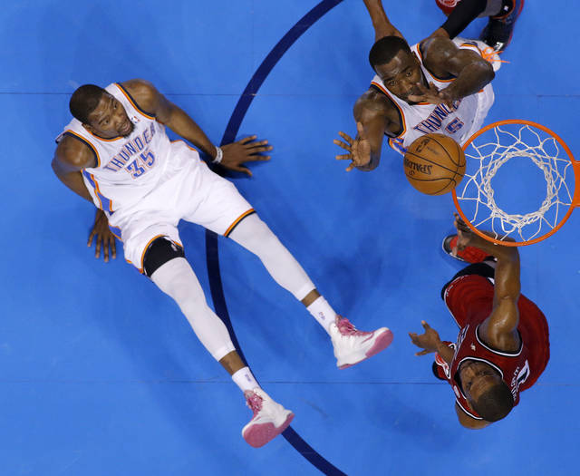 Oklahoma City's Kendrick Perkins (5) tries to tip the ball in beside Miami's Chris Bosh (1) as Oklahoma City's Kevin Durant (35) watches during an NBA basketball game between the Oklahoma City Thunder and the Miami Heat at Chesapeake Energy Arena in Oklahoma City, Thursday, Feb. 15, 2013. Photo by Bryan Terry, The Oklahoman