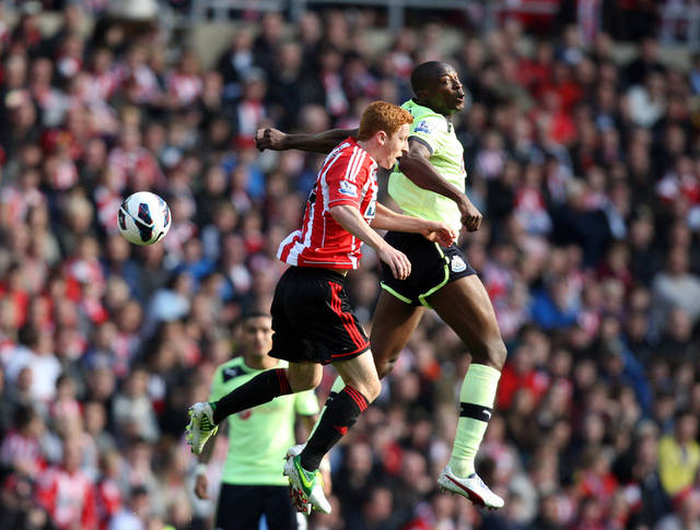 Sunderland's Jack Colback, left, vies for the ball with Newcastle United's Shola Ameobi during their English Premier League soccer match at the Stadium of Light, Sunderland, England, Sunday, Oct. 21, 2012. (AP Photo/Scott Heppell)