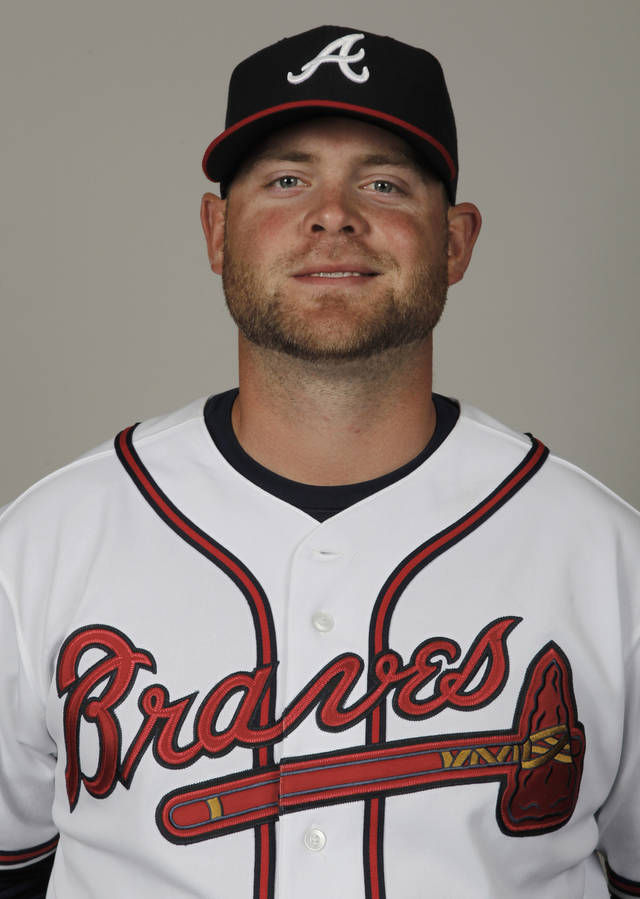 FILE - This 2012 file photo shows Brian McCann of the Atlanta Braves baseball team. McCann's status for the start of the 2013 season could be in question following surgery to repair a tear in his labrum that was bigger than expected. The team is still expected to pick up its $12 million option on the six-time All-Star, but it could need to look for help at the position in case McCann's recovery takes longer than expected. (AP Photo/Julio Cortez, File)