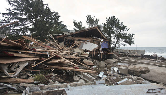 A beachfront house is completely destroyed in the aftermath of a superstorm Sandy, Tuesday, Oct. 30, 2012, in Coney Island's Sea Gate community in New York. (AP Photo/Bebeto Matthews) ORG XMIT: NYBM114