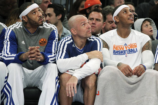 From left, New York Knicks' Kenyon Martin, Jason Kidd and Carmelo Anthony watch from the bench during the first half of an NBA basketball game against the Philadelphia 76ers, Sunday, Feb. 24, 2013, at Madison Square Garden in New York. (AP Photo/Mary Altaffer)