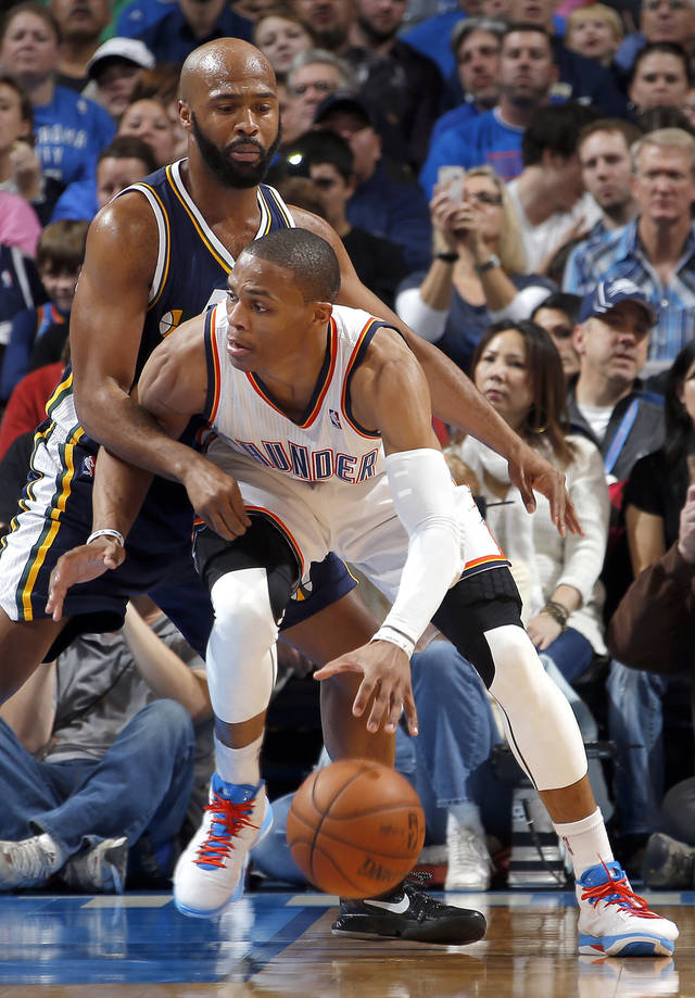 Oklahoma City's Russell Westbrook (0) tries to get around Utah's Jamaal Tinsley (6) during the NBA game between the Oklahoma City Thunder and the Utah Jazz and the Chesapeake Energy Arena, Friday,Nov. 30, 2012. Photo by Sarah Phipps, The Oklahoman