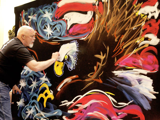 Artist and motivational speaker Richard Hight draws an eagle with the American flag during a  rally held to raise awareness about bullying in the House chambers at the state capital, Friday, May 11, 2012. Photo By David McDaniel/The Oklahoman