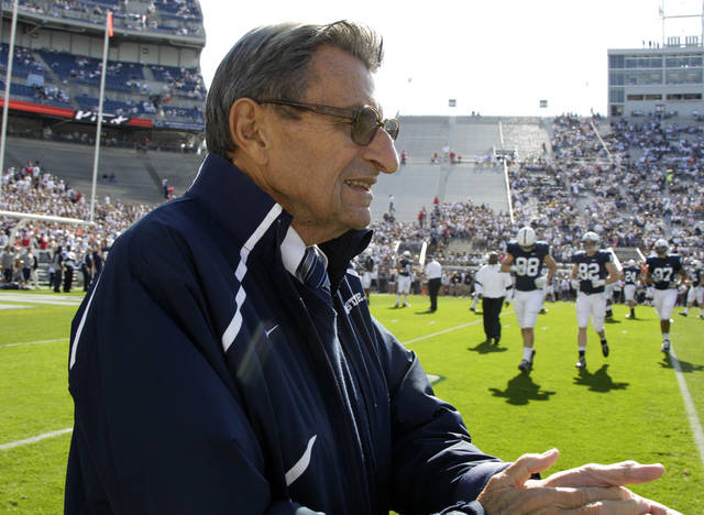 In this Oct. 8, 2011, file photo Penn St. head coach Joe Paterno walks onto the field for warmups before an NCAA college football game against Iowa in State College, Pa., Saturday, Oct. 8, 2011. Penn State won 13-3, leaving them 5-1 on the season. (AP Photo/Gene Puskar, File)