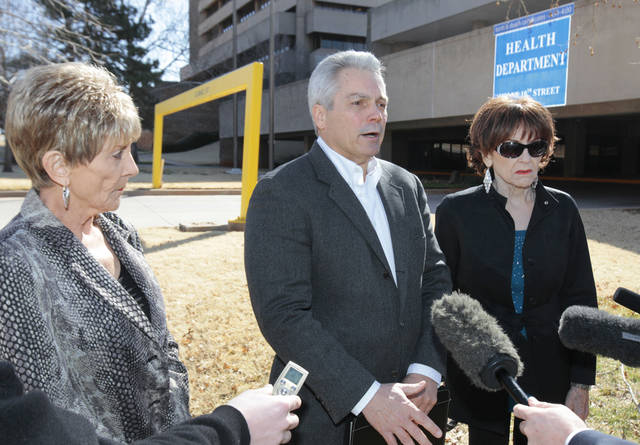 Sandra Cisper, Wes Bledsoe and Earlene Adkisson hold a news conference Thursday to discuss their efforts to reform nursing home regulation in Oklahoma. Photo By  David McDaniel, The Oklahoman