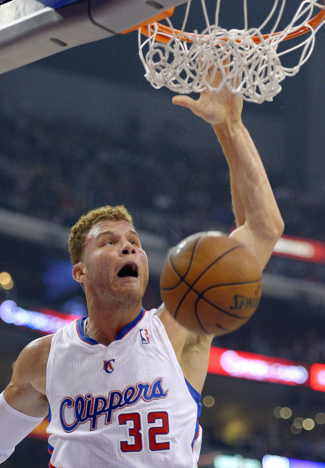 Los Angeles Clippers forward Blake Griffin dunks during the first half of their NBA basketball game against the Dallas Mavericks, Wednesday, Dec. 5, 2012, in Los Angeles. (AP Photo/Mark J. Terrill)