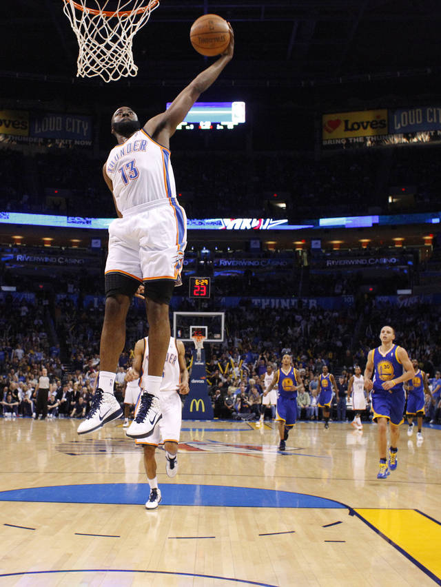 Oklahoma City's James Harden (13) goes up for a dunk during the NBA basketball game between the Oklahoma City Thunder and the Golden State Warriors at the Oklahoma City Arena, Tuesday, March 29, 2011. Photo by Bryan Terry, The Oklahoman