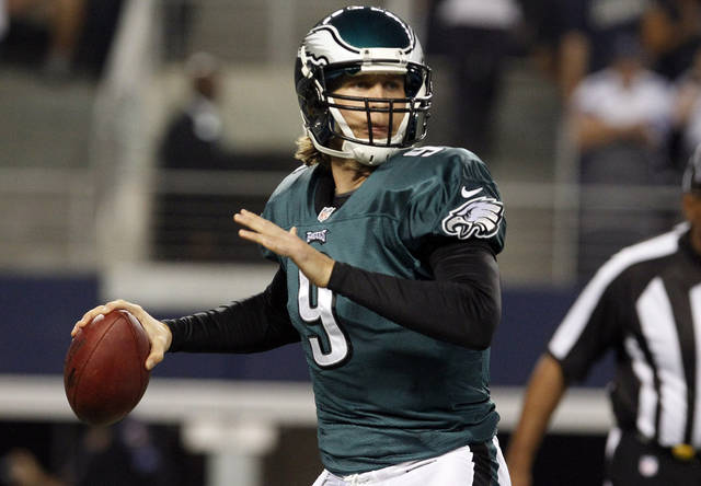 Philadelphia Eagles quarterback Nick Foles (9) passes the ball against the Dallas Cowboys during the first half of an NFL football game, Sunday, Dec. 2, 2012 in Arlington, Texas. (AP Photo/LM Otero)