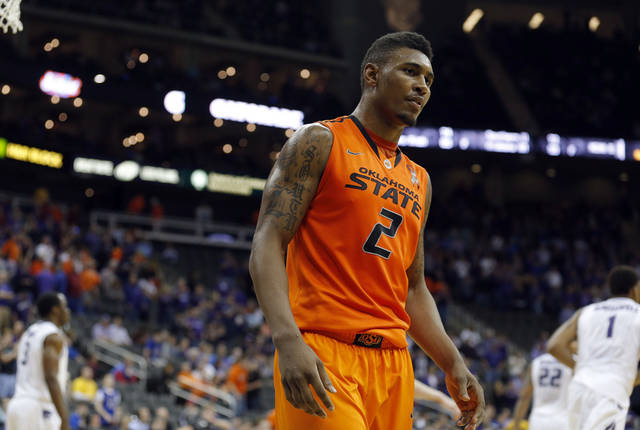 Oklahoma State's Le'Bryan Nash (2) walks off the court following the Phillips 66 Big 12 Men's basketball championship tournament game between Oklahoma State University and Kansas State at the Sprint Center in Kansas City, Friday, March 15, 2013. Photo by Sarah Phipps, The Oklahoman