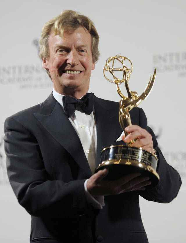 Producer Nigel Lythgoe poses with the Founders Award at the 39th International Emmy Awards, on Monday, Nov. 21, 2011, in New York. (AP Photo/Henny Ray Abrams)