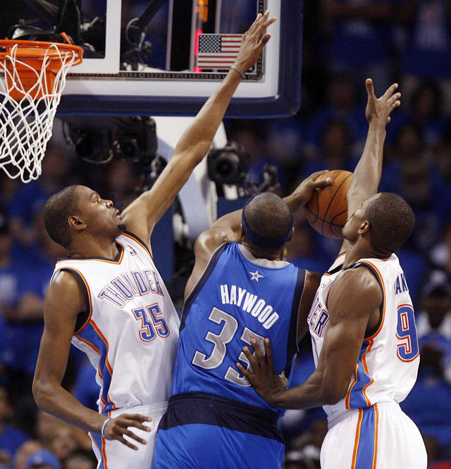 Oklahoma City's Kevin Durant (35) and Serge Ibaka (9) defend Dallas' Brendan Haywood (33) during game one of the first round in the NBA playoffs between the Oklahoma City Thunder and the Dallas Mavericks at Chesapeake Energy Arena in Oklahoma City, Saturday, April 28, 2012. Oklahoma City won, 99-98. Photo by Nate Billings, The Oklahoman