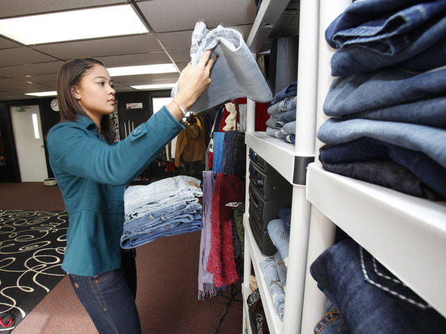 Student Mikella Green organizes clothing donations at Westmoore High School in Moore, OK, Tuesday, Nov. 22, 2011. Westmoore High School is being creative in giving back with a program for giving clothes to students who can't afford them. By Paul Hellstern, The Oklahoman