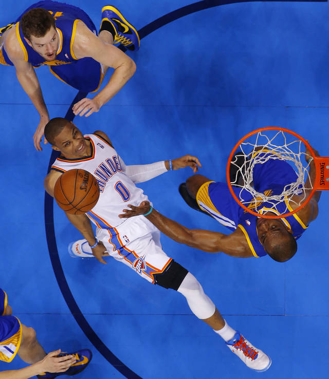 Oklahoma City's Russell Westbrook (0) watches the ball as he goes between Golden State's David Lee (10) and Carl Landry (7) during an NBA basketball game between the Oklahoma City Thunder and the Golden State Warriors at Chesapeake Energy Arena in Oklahoma City, Wednesday, Feb. 6, 2013. Photo by Bryan Terry, The Oklahoman