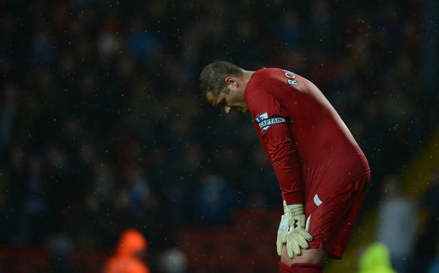 Blackburn's goalkeeper Paul Robinson hangs his head during his team's defeat to Wigan in their English Premier League soccer match at Ewood Park Stadium, Blackburn, England, Monday May 7, 2011. The loss relegates Blackburn from the Premier League. (AP Photo/Jon Super)