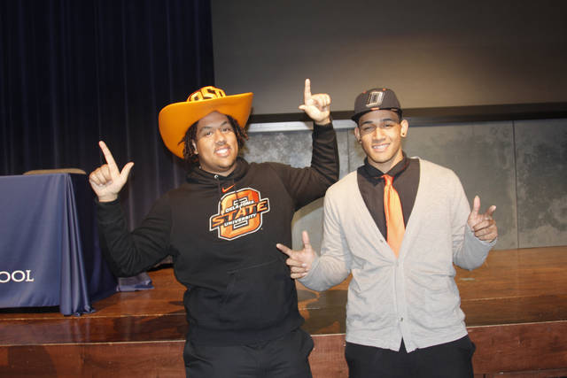 Oklahoma State football signees Jesse Robinson and Vili Leveni celebrate after signing their national letters of intent at L.D. Bell High School in Hurst, Texas. PHOTO BY GINA MIZELL, The Oklahoman
