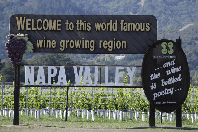 "In this photo taken Oct. 27, 2011, a sign along Highway 29 welcomes visitors to the Napa Valley in Oakville, Calif. Napa Valley wine producers will go a long way to protect their good name, all the way to Thailand if necessary. That's the latest country which has awarded Geographic Indication status to Napa wine, which means they've agreed not to allow sales of wine labeled ""Napa"" if the grapes inside aren't from that California region. (AP Photo/Eric Risberg)"