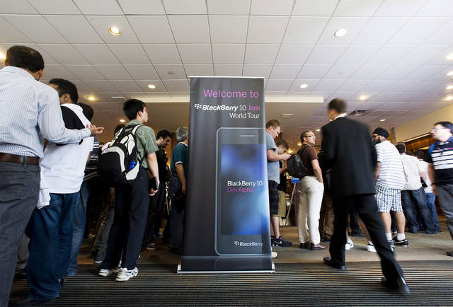 Guests are seen during Research In Motion Ltd.'s Blackberry 10 Jam World Tour in Toronto on Thursday June 21, 2012. The first BlackBerry device running RIM's new operating software will not have a physical keyboard, only a touch-screen one. RIM is expected to start selling BlackBerry 10 touch-screen devices this year. (AP Photo/The Canadian Press, Aaron Vincent Elkaim)