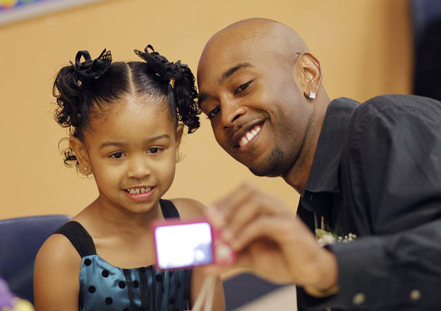 Cory Bobo and his kindergarten daughter Zekiyah Bobo, 5, take a photo of themselves at the Daddy-Daughter Dance at Britton Elementary School in Oklahoma City Friday, Feb. 10, 2012. Photo by Doug Hoke, The Oklahoman
