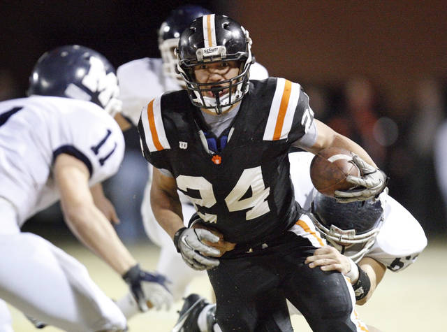 Josh Way (24) carries the ball for Wayne during a high school football playoff game between Wayne and Minco in Wayne, Okla., Friday, Nov. 25, 2011. Photo by Nate Billings, The Oklahoman