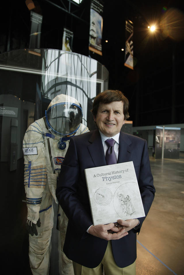 In this Tuesday, March 27, 2012, photo, Charles Simonyi, the only civilian to visit the International Space Station twice, poses for a photo next to a space suit similar to the one he once wore at the Seattle's Museum of Flight's new space gallery, which is named after him, in Seattle. The Microsoft billionaire is still obsessed with space, but has no plans to take a third trip, instead he's focused on publishing a physics book written by his father and continuing to work with the museum. (AP Photo/Ted S. Warren)