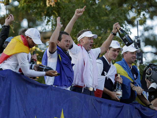 Europe's Sergio Garcia, left to right, Graeme McDowell, Ian Poulter, Justin Rose and Peter Hanson celebrate after winning the Ryder Cup PGA golf tournament Sunday, Sept. 30, 2012, at the Medinah Country Club in Medinah, Ill. (AP Photo/Charlie Riedel)  ORG XMIT: PGA238