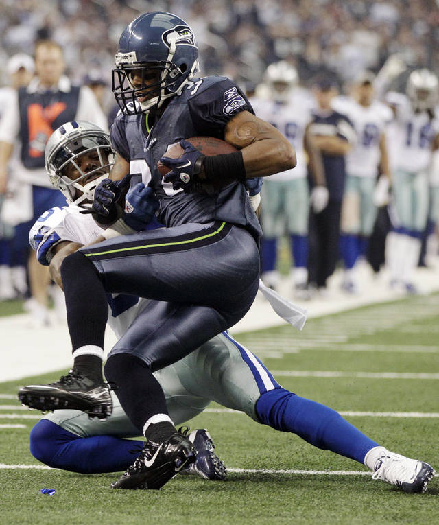 After recovering a fumble by Dallas Cowboys' Dez Bryant, Seattle Seahawks' Roy Lewis, front, is tackled by Dallas Cowboys' Kevin Ogletree during the first half of an NFL football game on Sunday, Nov. 6, 2011, in Arlington, Texas. (AP Photo/Tony Gutierrez)