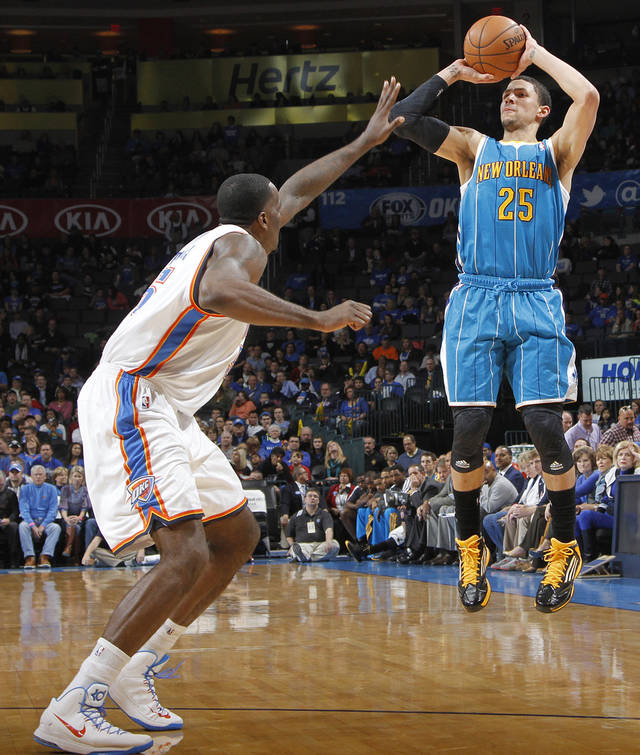 New Orleans Hornets' Austin Rivers (25) shoots over Oklahoma City Thunder's Kendrick Perkins (5) during the NBA basketball game between the Oklahoma CIty Thunder and the New Orleans Hornets at the Chesapeake Energy Arena on Wednesday, Dec. 12, 2012, in Oklahoma City, Okla.   Photo by Chris Landsberger, The Oklahoman