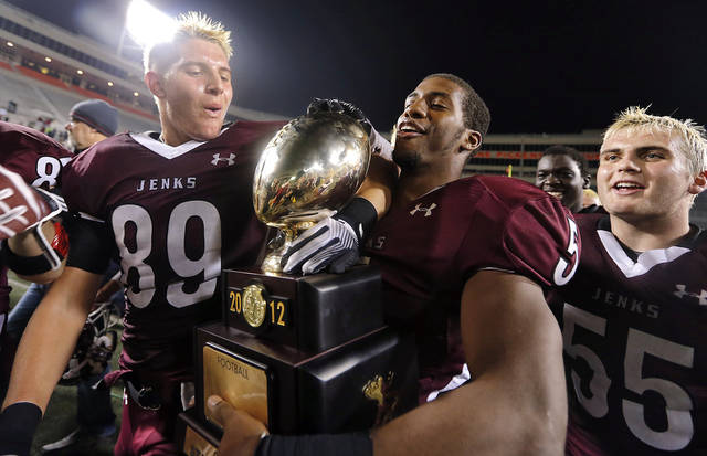 Jenks' Garrett Patterson (89), Trey'Vonne Barr'e (5) and Stewart White (55) celebrate the win over Norman North during the Class 6A Oklahoma state championship football game between Norman North High School and Jenks High School at Boone Pickens Stadium on Friday, Nov. 30, 2012, in Stillwater, Okla.   Photo by Chris Landsberger, The Oklahoman