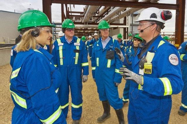 Gov. Mary Fallin, at left, toured Devon Energy Corp.'s Jackfish operation in Canada's oil sands on Monday. <strong>provided by Devon Energy Corp. - photo by Jean Becq</strong>