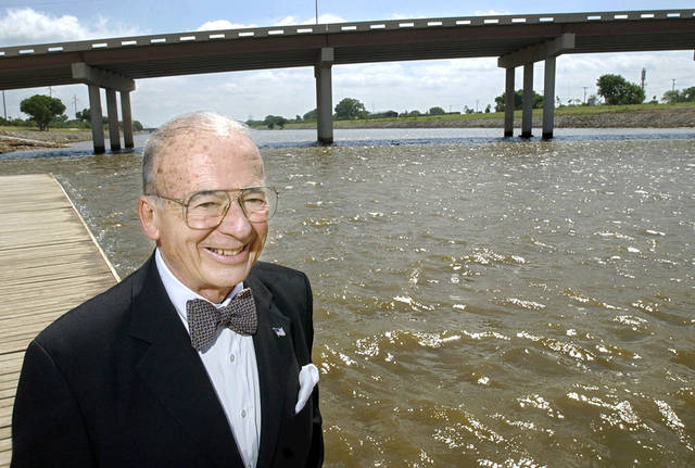 Oklahoma City business and civic leader Ray Ackerman stands along the shore of the Oklahoma River in this 2004 photo. His longtime advocacy for the waterway�s development will be recognized with a statue unveiling Friday at Regatta Park. Photo by Jim Beckel, The Oklahoman Archives