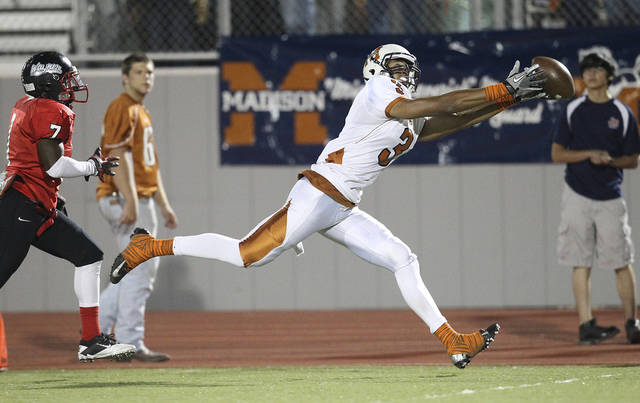 Madison's Dannon Cavil (03) stretches out for pass against Wagner's Robert Gardner (07) in the Class 5A District I playoff game in the first half at Rutledge Stadium on Friday, Nov. 16, 2012. Photo by Kin Man Hui, San Antonio Express-News ORG XMIT: 480245