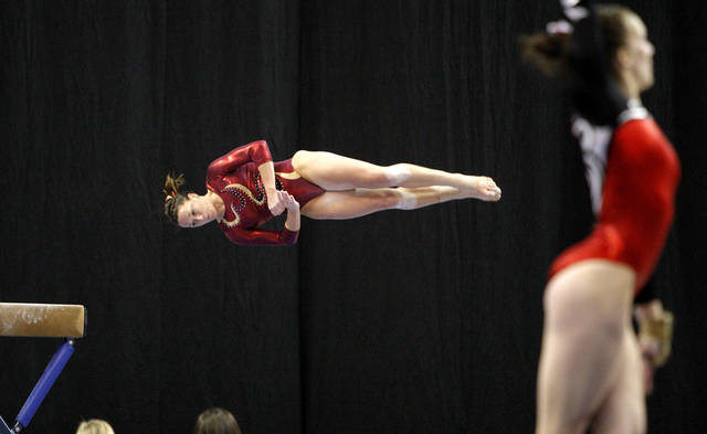 Iowa State's Shea Anderson competes on the beam during the Perfect 10 Challenge hosted by the Bart and Nadia Sports and Health Festival at the Cox Convention Center in Oklahoma City, Friday, Feb. 10, 2012. Photo by Bryan Terry, The Oklahoman
