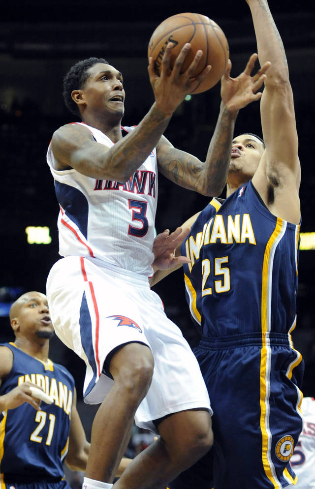 Atlanta Hawks guard Louis Williams (3) shoots as Indiana Pacers small forward Gerald Green (25) defends during the second half of an NBA basketball game on Saturday, Dec. 29, 2012, at Philips Arena  in Atlanta. Atlanta won 109-100. (AP Photo/John Amis)