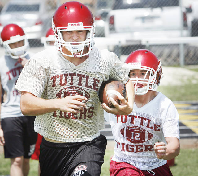 Tuttle's Ethan Biddy will carry the load at running back and at middle linebacker. PHOTO BY STEVE SISNEY, THE OKLAHOMAN