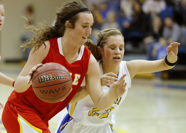 Dale's Danielle Dockrey goes past Bethel's Genna Robinson during their girls high school basketball game at Bethel High School in Shawnee, Okla., Friday, Feb. 1, 2013. Photo by Bryan Terry, The Oklahoman