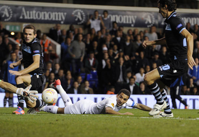 Tottenham Hotspur's captain Aaron Lennon, on the ground, tries unsuccessfully to score against Lazio during a Europa League Group J soccer match at White Hart Lane ground in London, Thursday, Sept. 20, 2012. (AP Photo/Tom Hevezi)
