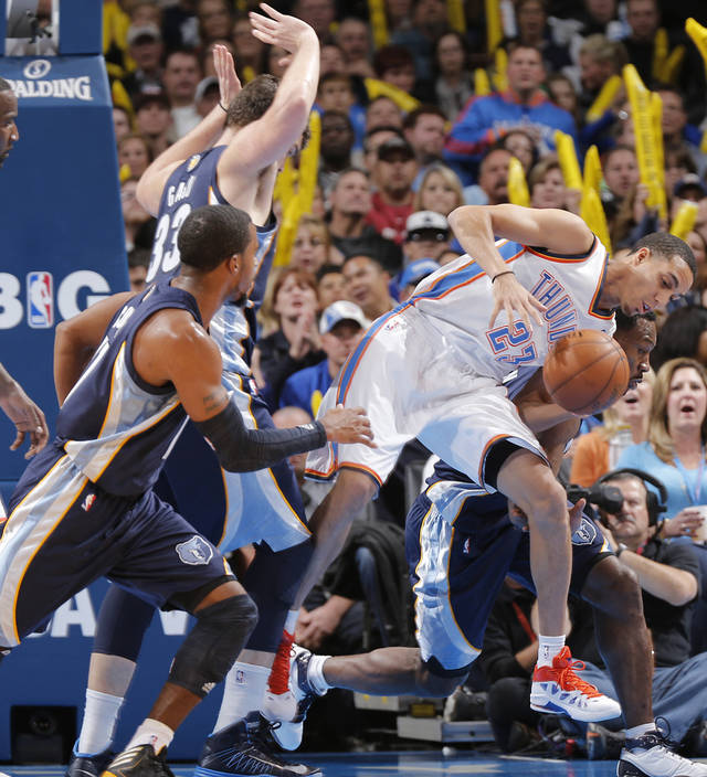 Oklahoma City's Kevin Martin (23) is fouled by Memphis' Marc Gasol (33) during the NBA basketball game between the Oklahoma City Thunder and the Memphis Grizzlies at Chesapeake Energy Arena on Wednesday, Nov. 14, 2012, in Oklahoma City, Okla.   Photo by Chris Landsberger, The Oklahoman